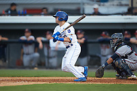 Mikey Filia (29) of the Burlington Royals follows through on his swing against the Danville Braves at Burlington Athletic Stadium on July 13, 2019 in Burlington, North Carolina. The Royals defeated the Braves 5-2. (Brian Westerholt/Four Seam Images)
