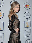 Taylor Swift attends Pre-GRAMMY Gala & Salute to Industry Icons with Clive Davis Honoring Lucian Grainge held at The Beverly Hilton Hotel in Beverly Hills, California on January 25,2014                                                                               © 2014 Hollywood Press Agency