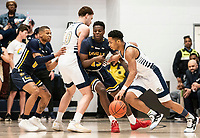 WASHINGTON, DC - FEBRUARY 22: Jameer Nelson Jr. #12 of George Washington dribbles past Sul Phiri #13 of La Salle during a game between La Salle and George Washington at Charles E Smith Center on February 22, 2020 in Washington, DC.