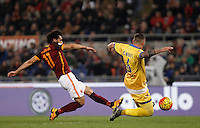 Calcio, Serie A: Roma vs Frosinone. Roma, stadio Olimpico, 30 gennaio 2016.<br /> Roma's Mohamed Salah, left, is challenged by Frosinone's Leonardo Blanchard during the Italian Serie A football match between Roma and Frosinone at Rome's Olympic stadium, 30 January 2016.<br /> UPDATE IMAGES PRESS/Isabella Bonotto