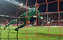 Dundee Utd keeper Radoslaw Cierzniak saves Dundee's Greg Stewart's penalty.