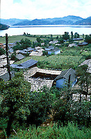 """A Mosuo village on the banks of Lugu lake in Yunnan. Lugu lake is said to have been formed by the footprint of a fleeing god. Women from the Mosuo tribe do not marry, take as many lovers as they wish and have no word for """"father"""" or """"husband"""". But the arrival of tourism and the sex industry is changing their culture...PHOTO BY SINOPIX"""