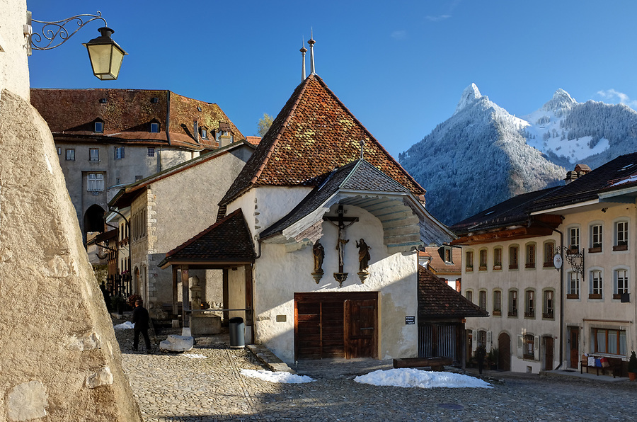Cobblestone street of the medieval town of Gruyères, Fribourg, Switzerland