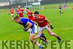 Templenoe Killian Spillane tackled by Daingean Uí Chúis Tom Leo Ó Súilleabhain during the CSFC match at Pairc an Aghasaigh, Dingle, on Saturday evening.