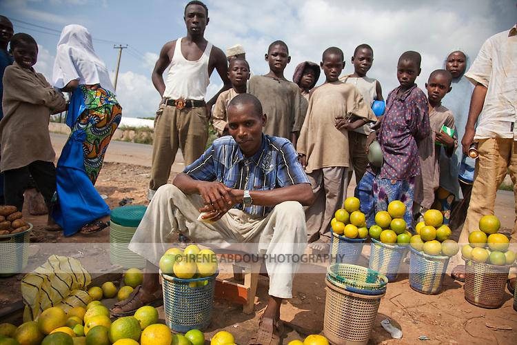 A Fulani man sells oranges at a roadside market in Nigeria's Niger State.