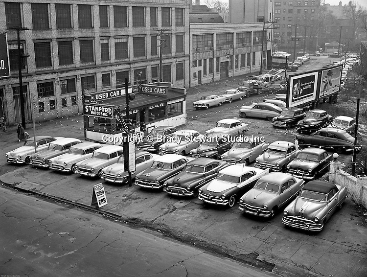 Client:  Stanford Motors<br /> Ad Agency: None / Sanford<br /> Product:  Used Automobiles<br /> Location: Baum Boulevard in East Liberty<br /> <br /> View of Stanford Motors used car lot in the East Liberty section of Pittsburgh.