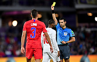 ORLANDO, FL - NOVEMBER 15: David Junior Hoilett #10 of Canada is shown yellow from referee Cesar Arturo Ramos Palazuelos during a game between Canada and USMNT at Exploria Stadium on November 15, 2019 in Orlando, Florida.