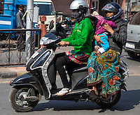 Jaipur, Rajasthan, India.  Mid-day Street Traffic in Central Jaipur.  Motorbikes Provide Family Transport.