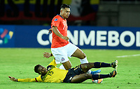 PEREIRA - COLOMBIA, 18-01-2020: Gustavo Cortes de Ecuador disputa el balón con Ivan Morales de Chile durante partido de la fecha 1, grupo A, del CONMEBOL Preolímpico Colombia 2020 jugado en el estadio Hernán Ramírez Villegas de Pereira, Colombia. /  Gustavo Cortes of Ecuador fights the ball with Ivan Morales of Chile during match of the date 1, group A, for the CONMEBOL Pre-Olympic Tournament Colombia 2020 played at Hernan Ramirez Villegas stadium in Pereira, Colombia. Photo: VizzorImage / Julian Medina / Cont