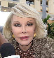 MIAMI BEACH, FL -  MARCH 18: Joan Rivers filming her new show in south beach , How did you get so rich. on March 18, 2010 in Miami Beach Florida.<br /> <br /> People:  Joan Rivers