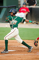 Carlos Paulino #1 of the Greensboro Grasshoppers follows through on his swing against the Kannapolis Intimidators at Fieldcrest Cannon Stadium August 2, 2010, in Kannapolis, North Carolina.  Photo by Brian Westerholt / Four Seam Images