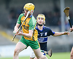 David Mescall of Inagh-Kilnamona in action against Conor Cahill of Kilmaley during their Minor A county final at Cusack Park. Photograph by John Kelly.