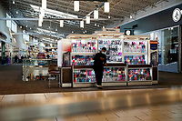 ELIZABETH, NEW JERSEY - MARCH 03: A worker watch his phone in a local mall on March 03, 2021 in Elizabeth, New Jersey. According projections the EE.UU economy rises 5,5% in 2021. where the excess savings in North American households will return to the market after vaccination and boosting consumption. (Photo by VIEWpress)