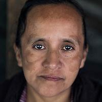 20 noviembre 2014. <br /> Maria Margarita Velazquez. 42 años. Activista en contra de la hidroeléctrica Ecoener, en Santa Cruz de Barillas, Guatemala.<br /> La llegada de algunas compañías extranjeras a América Latina ha provocado abusos a los derechos de las poblaciones indígenas y represión a su defensa del medio ambiente. En Santa Cruz de Barillas, Guatemala, el proyecto de la hidroeléctrica española Ecoener ha desatado crímenes, violentos disturbios, la declaración del estado de sitio por parte del ejército y la encarcelación de una decena de activistas contrarios a los planes de la empresa. Un grupo de indígenas mayas, en su mayoría mujeres, mantiene cortado un camino y ha instalado un campamento de resistencia para que las máquinas de la empresa no puedan entrar a trabajar. La persecución ha provocado además que algunos ecologistas, con órdenes de busca y captura, hayan tenido que esconderse durante meses en la selva guatemalteca.<br /> <br /> En Cobán, también en Guatemala, la hidroeléctrica Renace se ha instalado con amenazas a la población y falsas promesas de desarrollo para la zona. Como en Santa Cruz de Barillas, el proyecto ha dividido y provocado enfrentamientos entre la población. La empresa ha cortado el acceso al río para miles de personas y no ha respetado la estrecha relación de los indígenas mayas con la naturaleza. ©Calamar2/ Pedro ARMESTRE<br /> <br /> The arrival of some foreign companies to Latin America has provoked abuses of the rights of indigenous peoples and repression of their defense of the environment. In Santa Cruz de Barillas, Guatemala, the project of the Spanish hydroelectric Ecoener has caused murders, violent riots, the declaration of a state of siege by the army and the imprisonment of a dozen activists opposed to the project . <br /> A group of Mayan Indians, mostly women, has cut a path and has installed a resistance camp to prevent the enter of the company's machines. The prosecution has also provoked that some ecologists, wi