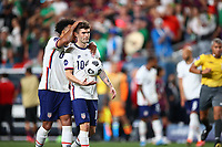 DENVER, CO - JUNE 6: Weston McKennie #8 of the United States encourages team mate Christian Pulisic #10 as he is about to take a PK during a game between Mexico and USMNT at Empower Field at Mile High on June 6, 2021 in Denver, Colorado.