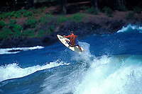 Man surfing on the upper west side of Maui