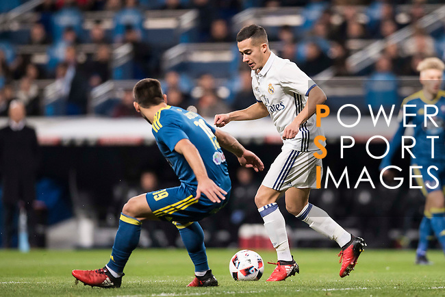 """Lucas Vazquez (r) of Real Madrid fights for the ball with Jonathan Castro Otto """"Jonny"""" of RC Celta de Vigo during their Copa del Rey 2016-17 Quarter-final match between Real Madrid and Celta de Vigo at the Santiago Bernabéu Stadium on 18 January 2017 in Madrid, Spain. Photo by Diego Gonzalez Souto / Power Sport Images"""