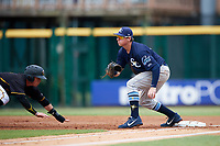 Charlotte Stone Crabs first baseman Brendan McKay (31) waits for a pickoff attempt throw as Mitchell Tolman (6) dives back to the bag safely during a game against the Bradenton Marauders on June 3, 2018 at LECOM Park in Bradenton, Florida.  Charlotte defeated Bradenton 10-1.  (Mike Janes/Four Seam Images)