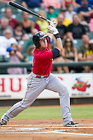 Oklahoma City RedHawks first baseman Matt Duffy (4) follows through on his swing during the Pacific Coast League baseball game against the Round Rock Express on August 1, 2014 at the Dell Diamond in Round Rock, Texas. The Express defeated the RedHawks 6-5. (Andrew Woolley/Four Seam Images)