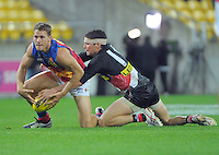 Leigh Montana strips the ball from Jack Redden during the Australian Rules Football ANZAC Day match between St Kilda Saints and Brisbane Lions at Westpac Stadium, Wellington, New Zealand on Friday, 25 April 2014. Photo: Dave Lintott / lintottphoto.co.nz