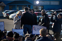 """Republican presidential candidate Mitt Romney, former governor of Massachusetts, speaks to a television reporter after a rally in Manchester, New Hampshire, on Sat. Dec. 3, 2011. The rally was called, """"Earn It with Mitt,"""" and was designed to bolster local efforts to help Romney """"earn"""" voters' support for the upcoming Republican primary."""
