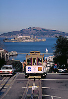 Cable Car; Alcatraz; tracks; tourist; landmark; public transit. San Francisco California.