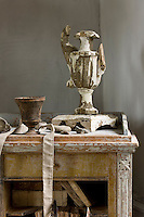 A badly damaged vase from an Italian church is displayed on a Gustavian bureau in the salon