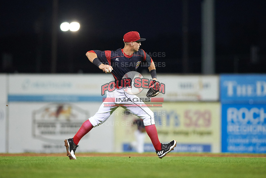Batavia Muckdogs third baseman Tyler Curtis (11) throws to first base during a game against the Tri-City ValleyCats on July 14, 2017 at Dwyer Stadium in Batavia, New York.  Batavia defeated Tri-City 8-4.  (Mike Janes/Four Seam Images)