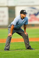 Umpire Charlie Ramos handles the calls on the bases during the Pioneer League game between the Orem Owlz and the Ogden Raptors at Lindquist Field on July 29, 2012 in Ogden, Utah.  The Owlz defeated the Raptors 6-4.   (Brian Westerholt/Four Seam Images)