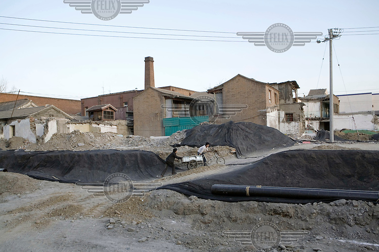 Old areas in Beijing, such as Qianmen, are being demolished and the local inhabitants resettled in order to make way for a massive face-lift in preparation for the 2008 Olympic Games.