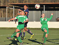 20131211 - HENIN-BEAUMONT , France :  PSG's Marie-Laure Delie pictured heading the ball in between Henin's Charlotte Blanchard (left) and Henin's  Morgane Duporge (right) during the female soccer match between FC Henin Beaumont and Paris Saint-Germain Feminin , of the Ninth matchday in the French First Female Division . Wednesday 11 December 2013. PHOTO DAVID CATRY