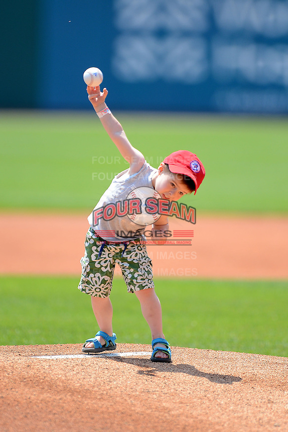 Buffalo Bisons young fan throws out the ceremonial first pitch before a game against the Charlotte Knights on May 19, 2013 at Coca-Cola Field in Buffalo, New York.  Buffalo defeated Charlotte 11-6.  (Mike Janes/Four Seam Images)