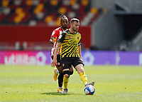 1st May 2021; Brentford Community Stadium, London, England; English Football League Championship Football, Brentford FC versus Watford; Tom Cleverley of Watford passing the ball into midfield while pressured by Tariqe Fosu of Brentford