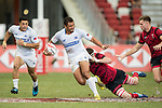 A Welsh player tries to tackle Alamanda Motuga of Samoa during the match Wales vs Samoa, Day 2 of the HSBC Singapore Rugby Sevens as part of the World Rugby HSBC World Rugby Sevens Series 2016-17 at the National Stadium on 16 April 2017 in Singapore. Photo by Victor Fraile / Power Sport Images