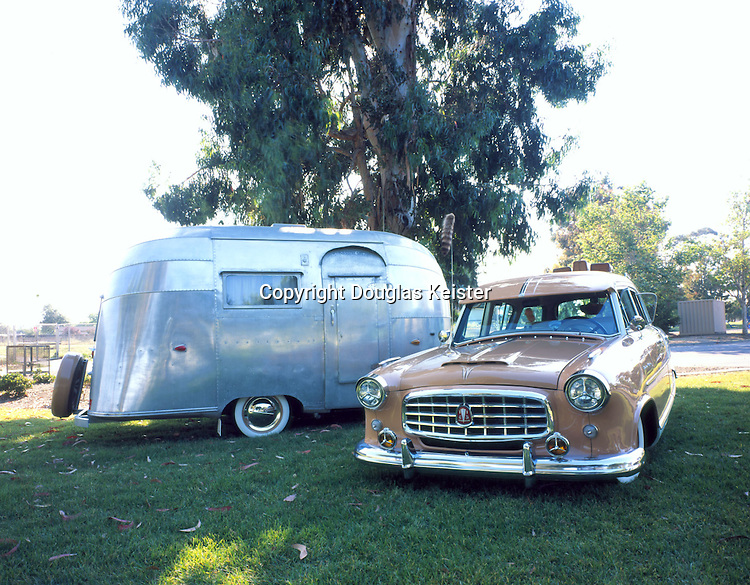 The tidy profile of the Bubble trailer and its modest weight makes it a fabulous accessory for a mid 1950's automobile. The owner, a fireman and an avid automobile and motorcycle restorer and collector purchased this 1955 Bubble in 2001 from a couple in Reno, Nevada. The trailer is in original condition; nothing has been changed since it rolled off the lot in 1955. The tow vehicle is a 1955 Hudson Rambler Super Cross Country Wagon. The original power plant has been replaced with a beefier 1978 Buick V6 engine.