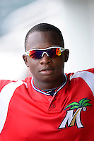 Fort Myers Miracle third baseman Miguel Sano #24 in the dugout before a game against the Jupiter Hammerheads on April 9, 2013 at Hammond Stadium in Fort Myers, Florida.  Fort Myers defeated Jupiter 1-0.  (Mike Janes/Four Seam Images)