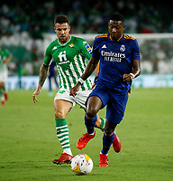 28th August 2021; Benito Villamarín Stadium, Seville, Spain, Spanish La Liga Football, Real Betis versus Real Madrid; Real Madrid player Alaba holds off the ball against Betis player Betico Aitor