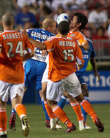 Houston's Brian Ching takes a ball in the face as he challenges Kansas City's Matt Groenwald for the ball while Dynamo teammates Wade Barrett and Alejandro Moreno look on.  Kansas City beat Houston 2-1 at Robertson Stadium in Houston, TX on Saturday April 8, 2006.