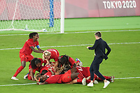 YOKOHAMA, JAPAN - AUGUST 6: Canada players including Kadeisha Buchanan #3, Adriana Leon #9 and Deanne Rose #6 celebrate winning the gold medal during a game between Canada and Sweden at International Stadium Yokohama on August 6, 2021 in Yokohama, Japan.