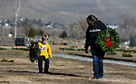 As part of National Wreaths Across America Day, volunteers Jennifer Riesen and her son Noah, 4, place wreaths on the graves of veterans at the Lone Mountain Cemetery, in Carson City, Nev., on Saturday, Dec. 19, 2020. The program honors veterans at more than 2100 cemeteries around the world. <br /> Photo by Cathleen Allison/Nevada Momentum Fueled by RAD