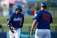 DJ Gladney (8) of the Kannapolis Cannon Ballers is greeted by manager Guillermo Quiroz (40) as he rounds third base after hitting a home run against the Carolina Mudcats at Atrium Health Ballpark on June 10, 2021 in Kannapolis, North Carolina. (Brian Westerholt/Four Seam Images)