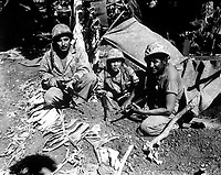 Navajo Indian communication men with the Marines on Saipan landed with the first assault waves to hit the beach. Ca. June 1944. J. L. Burns (Marine Corps)<br /> Exact Date Shot Unknown<br /> NARA FILE #:  127-N-82619<br /> WAR & CONFLICT BOOK #:  1193