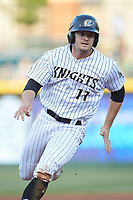 Adam Engel (11) of the Charlotte Knights hustles toward third base against the Rochester Red Wings at BB&T BallPark on May 14, 2019 in Charlotte, North Carolina. The Knights defeated the Red Wings 13-7. (Brian Westerholt/Four Seam Images)