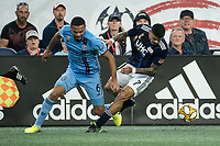 FOXBOROUGH, MA - SEPTEMBER 29: Alexander Callens #6 of New York City FC and Gustavo Bao #7 of New England Revolution compete for the ball during a game between New York City FC and New England Revolution at Gillettes Stadium on September 29, 2019 in Foxborough, Massachusetts.