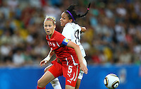 USA's Sydney Leroux (R) and Danique Stein of Switzerland during the FIFA U20 Women's World Cup at the Rudolf Harbig Stadium in Dresden, Germany on July 17th, 2010.