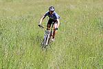 Tristan Rawlence cuts through the grass.  Mammoth Adventure MTB Ride, Nelson<br /> Photo: Marc Palmano/shuttersport.co.nz