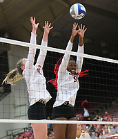 Arkansas Senior Gracie Ryan (21) and Arkansas Graduate Student Abigail Archibong (9) block ball against Auburn on Sunday, Oct. 10, 2021, during play at Barnhill Arena, Fayetteville. Visit nwaonline.com/211011Daily/ for today's photo gallery.<br /> (Special to the NWA Democrat-Gazette/David Beach)