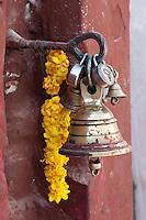 Bodhnath, Nepal.  Bell and Garland outside an Entrance to the Bodhnath Stupa.
