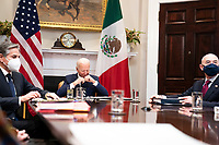 United States President Joe Biden, flanked by US Secretary of State Antony Blinken, left and United States Secretary of Homeland Security Alejandro Mayorkas, right, listens during a virtual bilateral meeting with President Andrés Manuel López Obrador of Mexico in the Roosevelt Room of the White House in Washington on March 1st, 2021. <br /> Credit: Anna Moneymaker / Pool via CNP /MediaPunch
