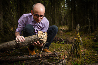 UAA associate professor of public health Philippe Amstislavski collects samples of some of the fungi found in the forests around UAA which are similar to those his team has used to develop a lightweight packaging alternative to Styrofoam.